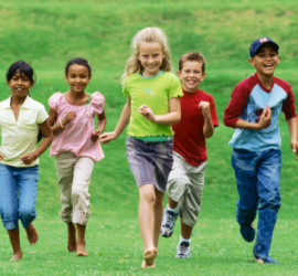 Portrait of a group of children running